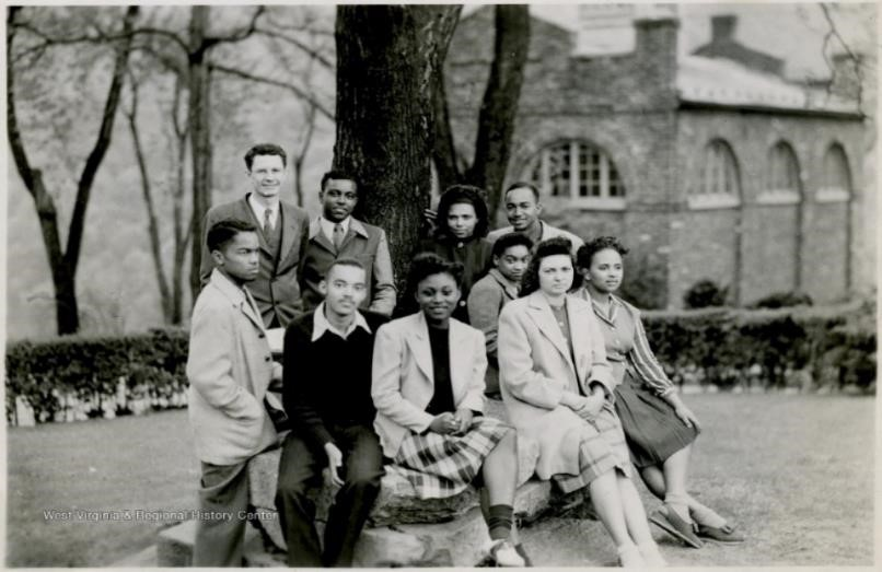 Group of African-American students in front of a tree