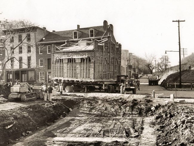 Harpers Ferry engine house being transported on the bed of a truck