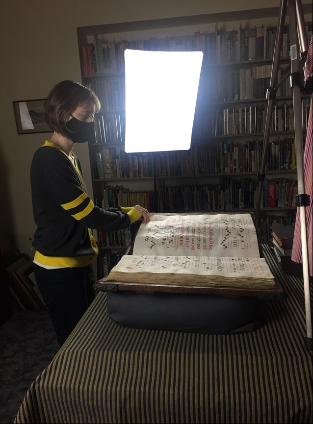 Woman turning the pages of a large book