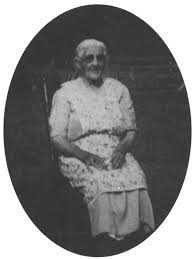 Mollie Gabe, seated