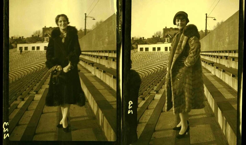 Two female students posing at Mountaineer Field