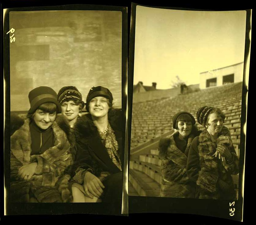 Two groups of female students posing at Mountaineer Field