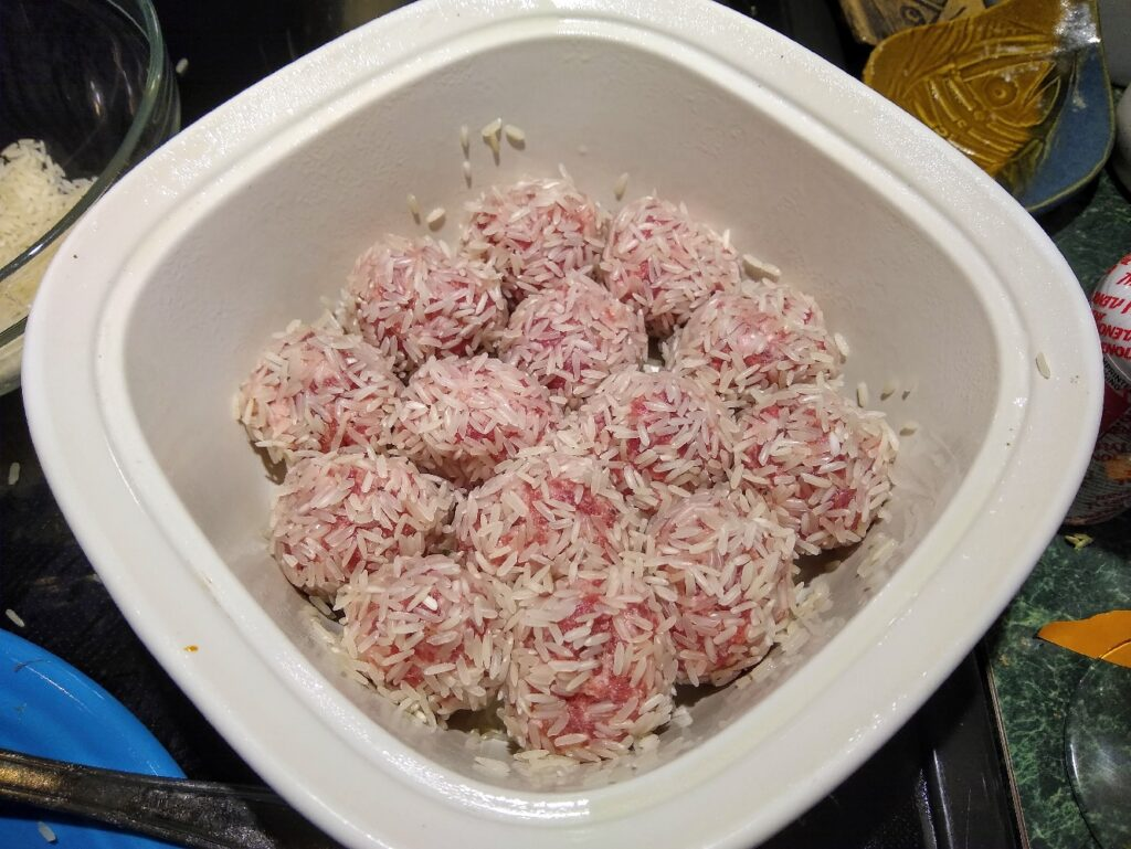 Rice covered porcupine sausage balls in a bowl