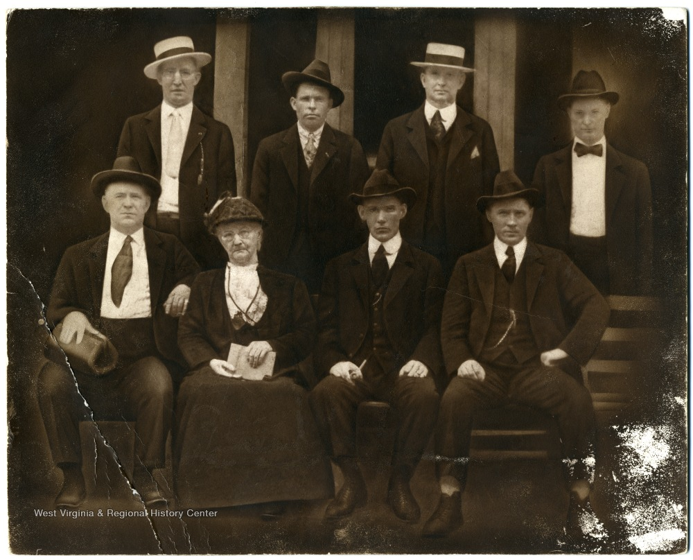 Mother Jones seated with notable West Virginians including Sid Hatfield, who sits to Jones' left.