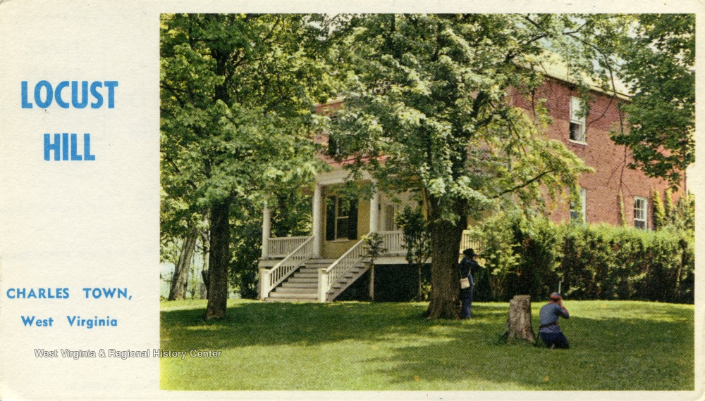 Postcard showing two trees and visitors in from of Locust Hill building