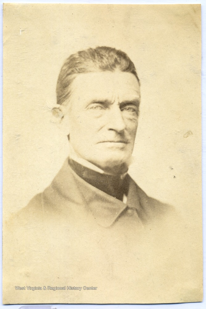John Brown, as he looked a few years before his infamous raid. He is wearing a coat and necktie and looking into the camera.